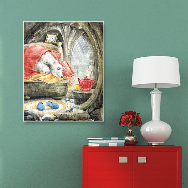 Stylish red chest with white table lamp and decoration on background of blue wall